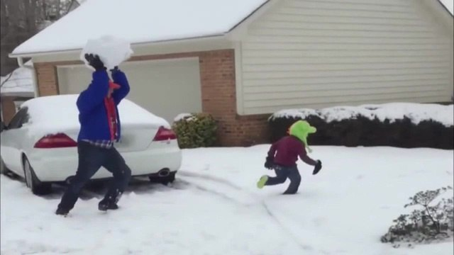 Dad Throws Giant Snowball at Kid FATALITY