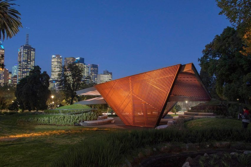 Carme Pinós unveils origami-inspired MPavilion raised up on grass mounds