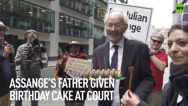 Julian Assange's father given birthday cake outside the Old Bailey